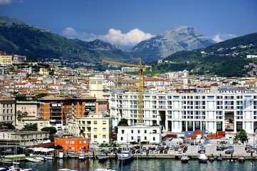Apartments and the harbour of Salerno