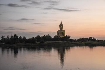 big buddha and reflection,river