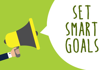 Conceptual hand writing showing Set Smart Goals. Business photo showcasing Establish achievable objectives Make good business plans Man holding loudspeaker speech bubble message speaking loud.