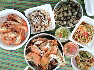 Many Steamed seafood on plate at Thai street food market