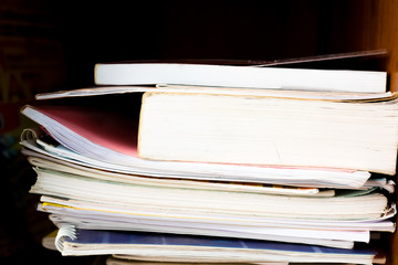 Stack of books background. many books piles. High books stack on