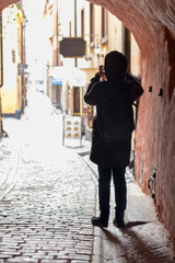 Tourist taking picture in Old Town in Stockholm