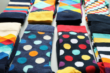 Fototapete - Composition with different colorful socks, closeup