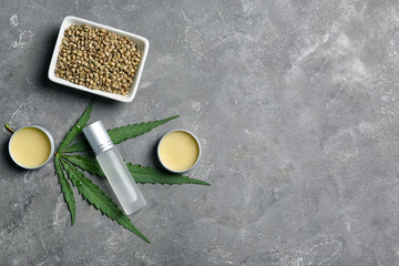 Flat lay composition with hemp lotion and space for text on grey background