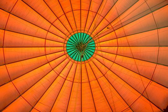 Symmetrical view of orange balloon