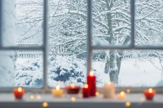 burning candles on a windowsill