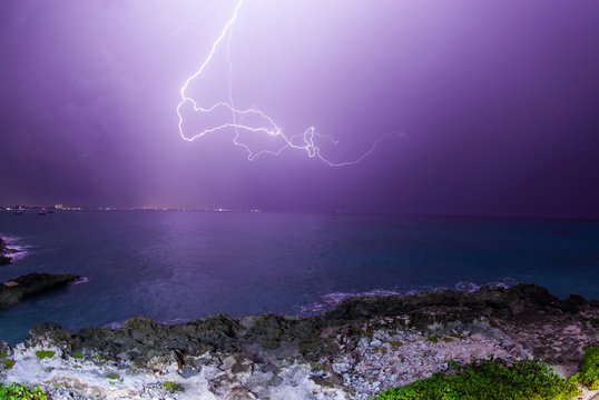 A lightening storm that has raged through the Caribbean has passed over the Cayman islands and blasted forks of intense electricity down onto the island and the ocean around