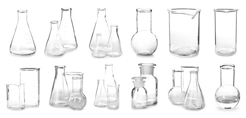 Set with clean laboratory glassware for chemical analysis on white background
