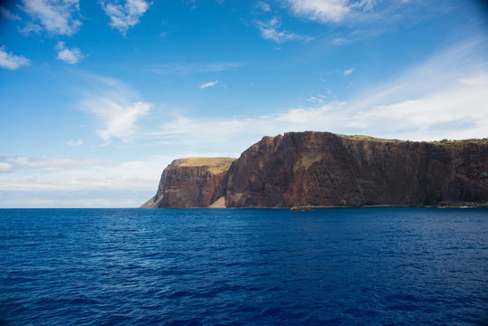 Cliffs on the island of Lanai, Hawaii, as seen from a boat on a clear sunny day