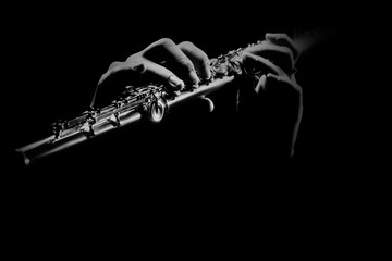 Photo sur Aluminium Musique Flute instrument. Flutist hands playing flute music