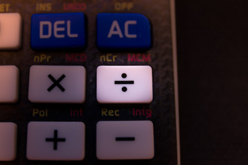 Dividing key of a scientific calculator keyboard