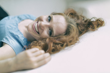 Young redheaded woman with sweet laugh