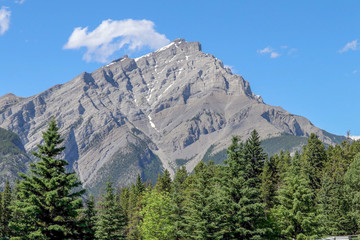 Rocky Mountains, Blue Sky with Clouds, Fur Trees in Banff, Alberta, Canada