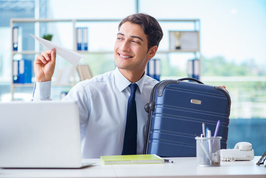 Businessman thinking of vacation travel