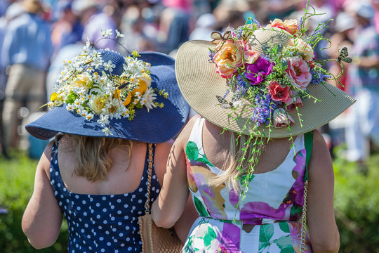 Women Wearing Derby Hats at Horse Race