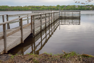 Beautiful fishing dock and calm waters on Starring Lake in Minnesota