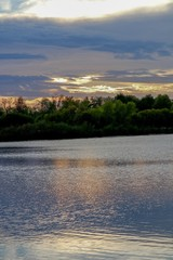 Beautiful sunset with clouds and reflection in the water at Purgatory Creek Park in Minnesota