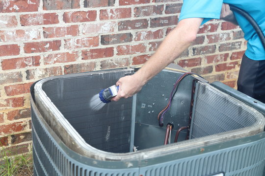 Hand cleaning air conditioner condenser coils