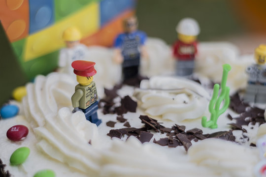 NEW YORK, USA - AUG 10, 2018 : Lego minifigure characters mounted on a birthday cake.