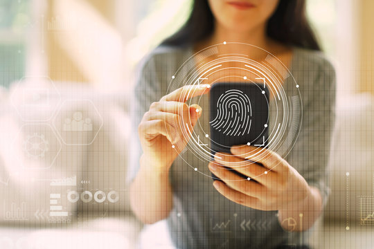 Fingerprint scanning technology with woman using her smartphone