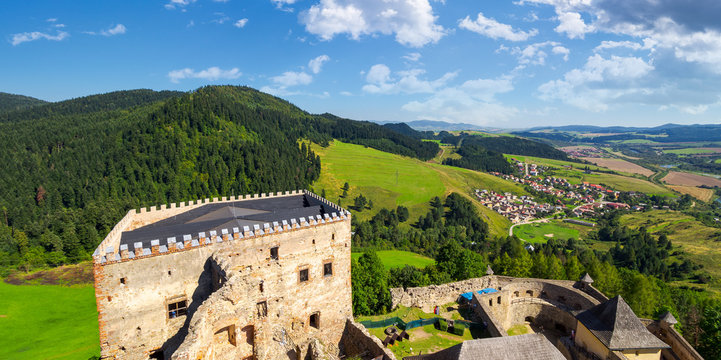 Stara Lubovna, Slovakia - AUG 28, 2016: view from the top of castle wall. beautiful rural landscape. village at the foot of the forested hill
