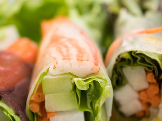 Spring rolls and salad close up