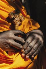 An Ethiopian monk holds a wooden cross.