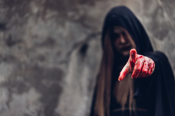Portrait woman ghost devil she has point finger out and hand have red blood