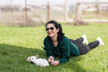 Woman laying on grass with bunnys