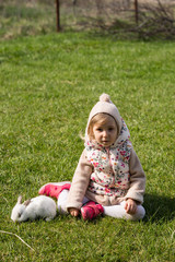 Girl sitting in gardenn with her bunny