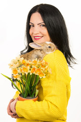 Beautiful woman with rabbit and flowers
