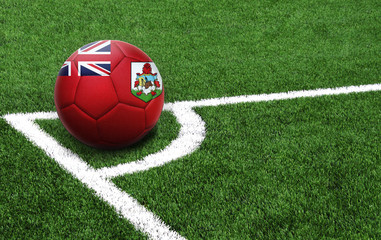 soccer ball on a green field, flag of Bermuda Islands
