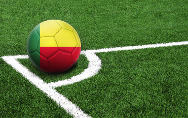 soccer ball on a green field, flag of Benin