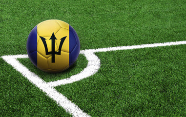soccer ball on a green field, flag of Barbados