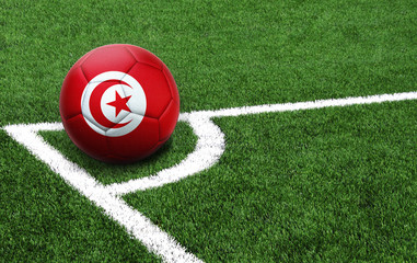 soccer ball on a green field, flag of Tunisia