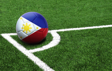 soccer ball on a green field, flag of Philippines