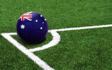 soccer ball on a green field, flag of Australia
