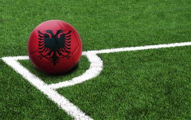 soccer ball on a green field, flag of Albania