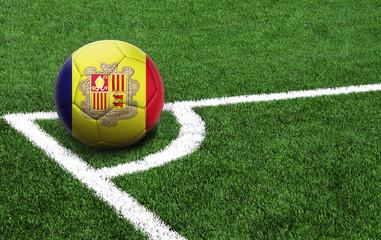 soccer ball on a green field, flag of Andorra