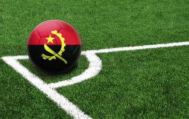soccer ball on a green field, flag of Angola