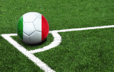 soccer ball on a green field, flag of Italy