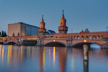 The Oberbaumbridge and the river Spree in Berlin at dusk