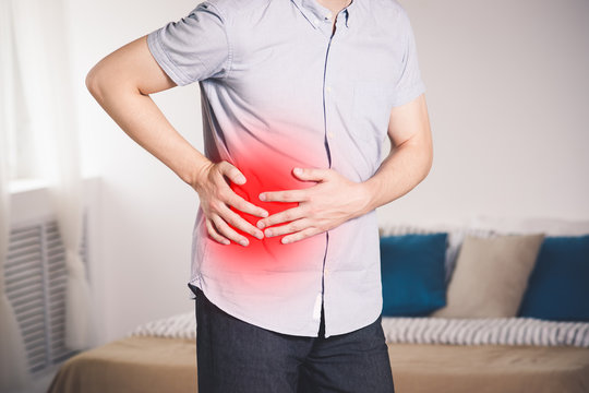 Attack of appendicitis, man with abdominal pain suffering at home