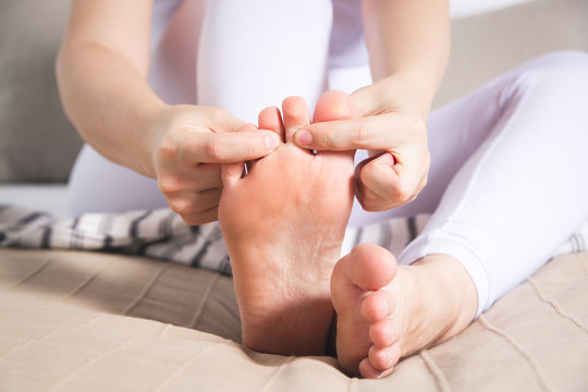 Woman's leg hurts, pain in the foot, massage of female feet