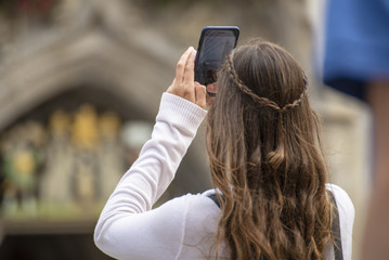 girl taking a picture with smartphone