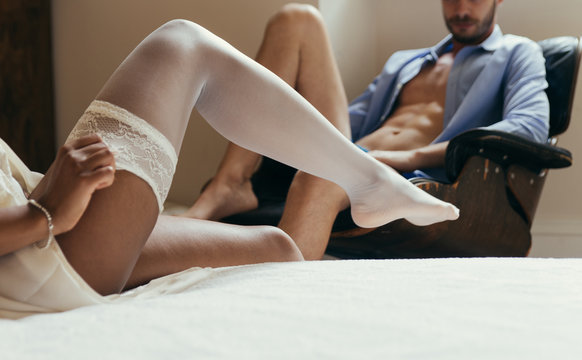 Couple in love spending time together in the house. Romantic moments in the bedroom