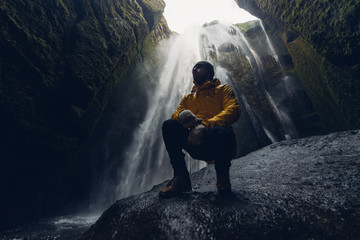 Man exploring iceland. Wanderlust explorer discovering icelandic natural wonders