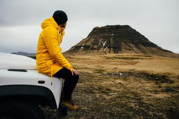 Man exploring iceland. Driving through the lands