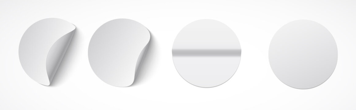 Set of round white sticky labels with bent edges. Empty mockup for memos, price tags, gluing.