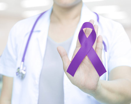 Female doctor in white uniform hold purple violet ribbon awareness in hand for ADD,ADHD,Alzheimer's Disease ,Arnold Chiari Malformation,Childhood Hemiplegia & stroke,Pancreatic cancer,Sarcoidosis